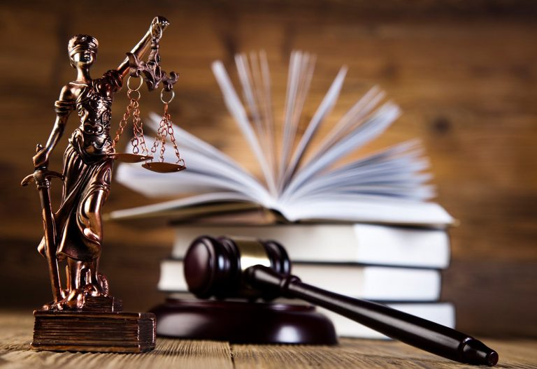 lady justice with gavel and open book