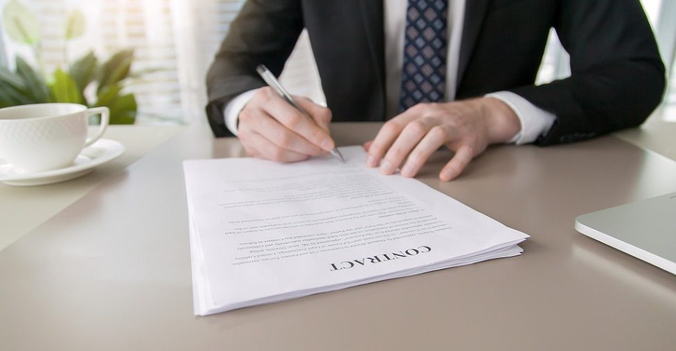 lawyer signing contract