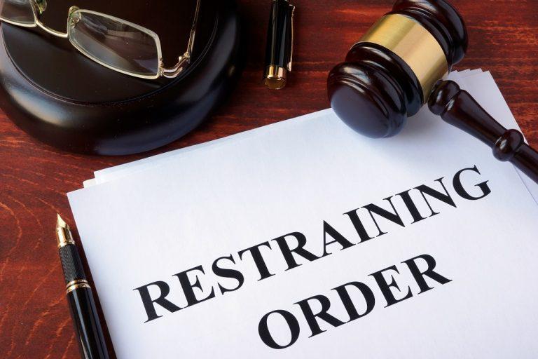 restraining order paperwork and gavel